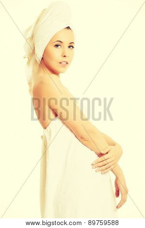 Beautiful young woman wrapped in towel