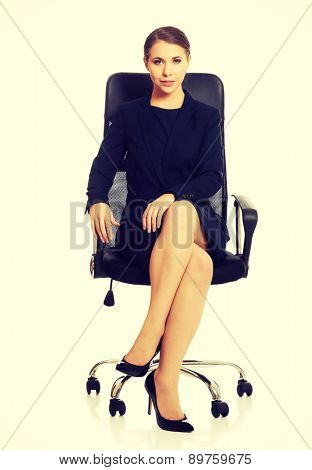 Young businesswoman sitting on chair