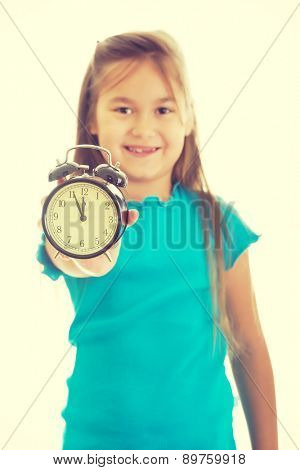 Cute little girl holding the clock