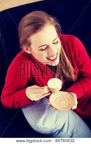Young beautiful woman drinking coffee