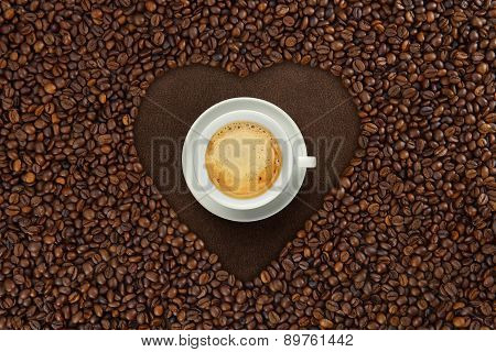 Cup Of Coffee In The Heart Of Coffee Seeds