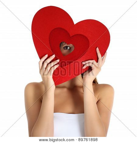 girl with the hands making a heart shape