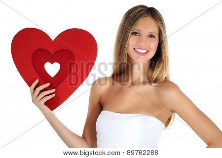 smiling girl holding a heart shape