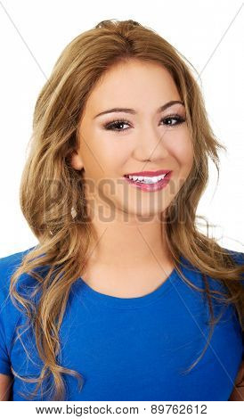Friendly smiling young woman with make up.