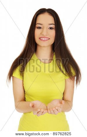 Young student woman showing empty palms.