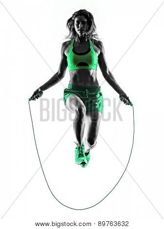 one caucasian woman exercising  Jumping Rope fitness in studio silhouette isolated on white background