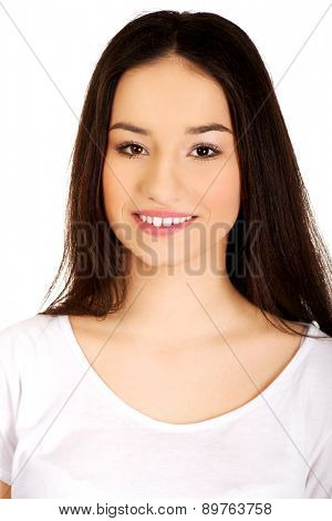Friendly smiling young student woman.