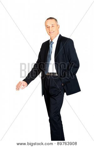 Mature businessman leaning on empty blank on the floor.