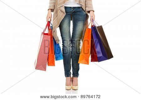 Woman holding many shopping bags.