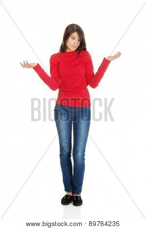 Beautiful woman making a scale with her arms wide open.