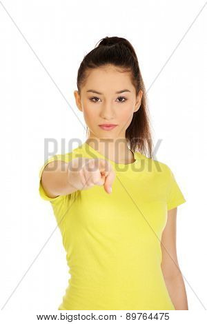 Young student woman pointing on you.