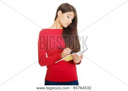 Female student with notebook and pen.