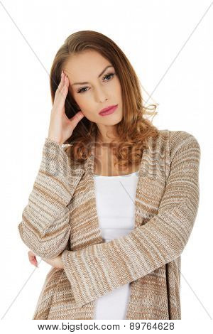 Casual depressed woman holding head.