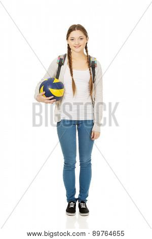 Teenager with schoolbag and volley ball.