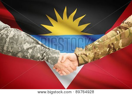 Men In Uniform Shaking Hands With Flag On Background - Antigua And Barbuda