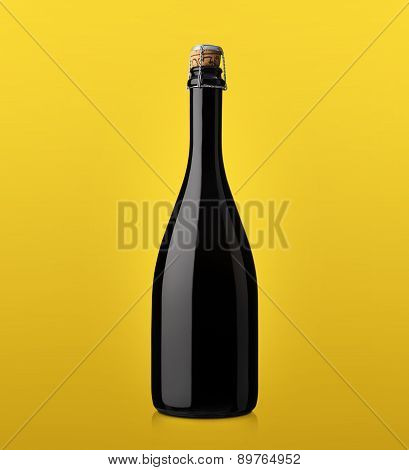 Bottle Of Sparkling Wine With Cork On A Colored Background Yellow