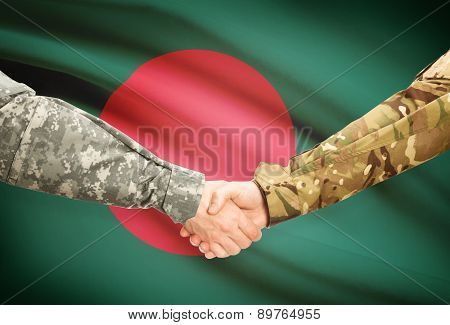 Men In Uniform Shaking Hands With Flag On Background - Bangladesh