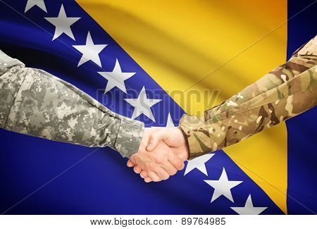 Men In Uniform Shaking Hands With Flag On Background - Bosnia And Herzegovina