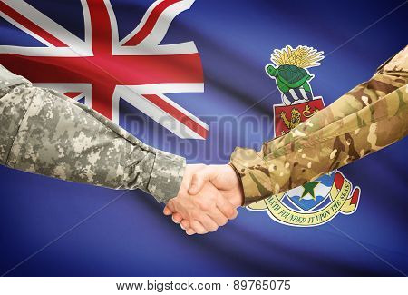 Men In Uniform Shaking Hands With Flag On Background - Cayman Islands