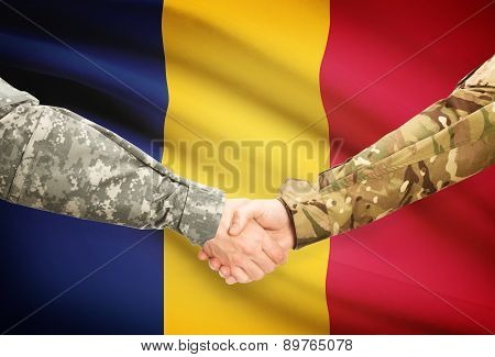 Men In Uniform Shaking Hands With Flag On Background - Chad