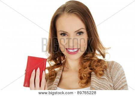 Beautiful happy woman with wallet.