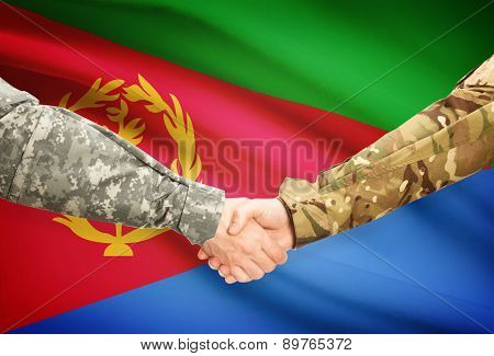 Men In Uniform Shaking Hands With Flag On Background - Eritrea