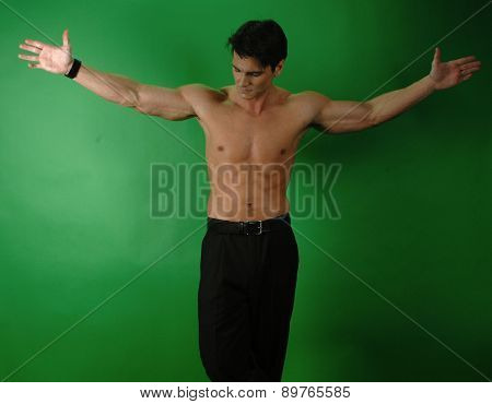 man with arms stretched