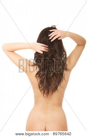 Beautiful sensual woman touching her hair.