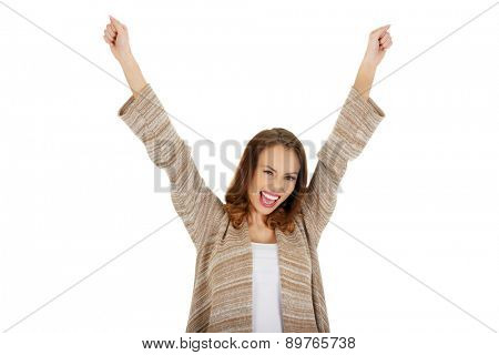 Happy successful woman in winner gesture.