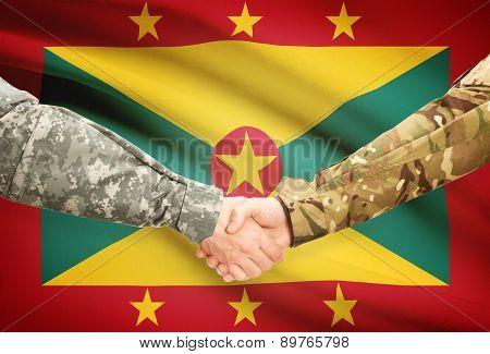 Men In Uniform Shaking Hands With Flag On Background - Grenada