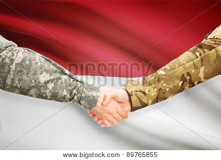 Men In Uniform Shaking Hands With Flag On Background - Indonesia
