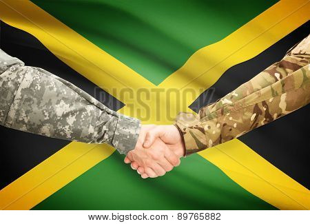 Men In Uniform Shaking Hands With Flag On Background - Jamaica