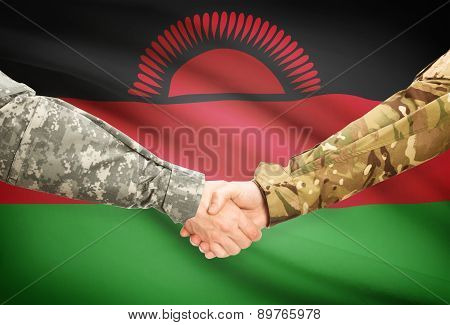 Men In Uniform Shaking Hands With Flag On Background - Malawi