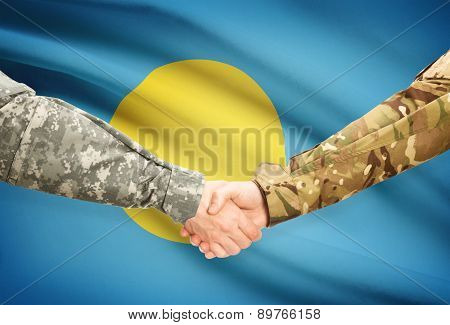 Men In Uniform Shaking Hands With Flag On Background - Palau