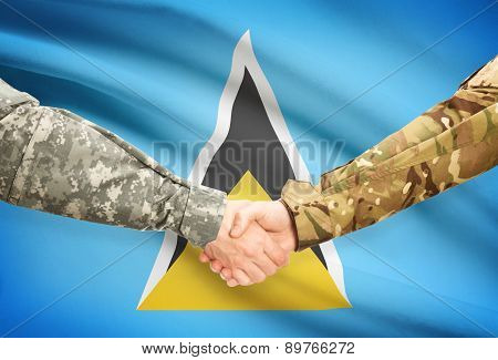 Men In Uniform Shaking Hands With Flag On Background - Saint Lucia