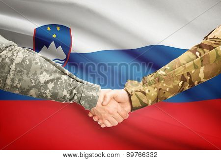 Men In Uniform Shaking Hands With Flag On Background - Slovenia