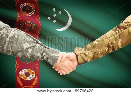 Men In Uniform Shaking Hands With Flag On Background - Turkmenistan