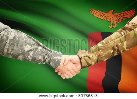 Men In Uniform Shaking Hands With Flag On Background - Zambia