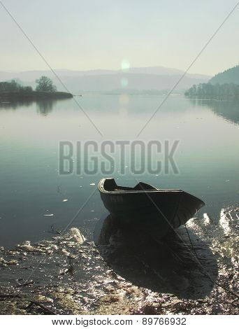 boat on a river bank