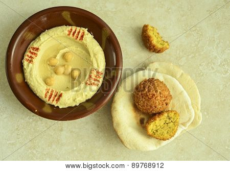 Bowl of Hummus, with fried falafel and pita bread - a popular middle-eastern food.