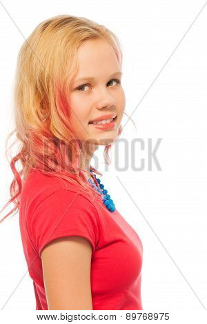 Profile portrait of blond smiling girl isolated