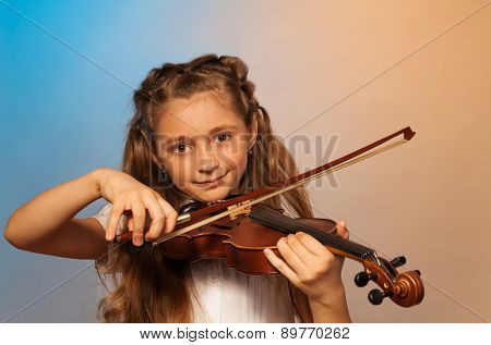Girl playing the violin isolated on gel background