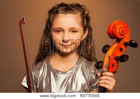 Close-up view of smiling girl with cello isolated