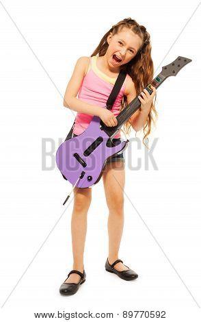 Singing girl rocks playing on electro guitar