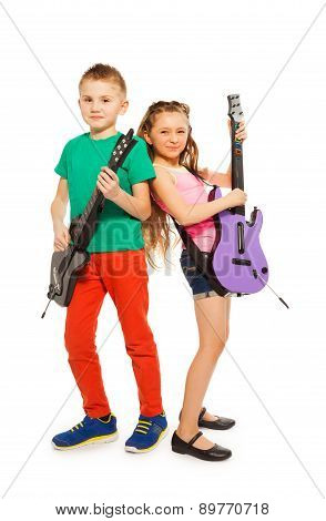 Girl and boy together playing on electro guitars