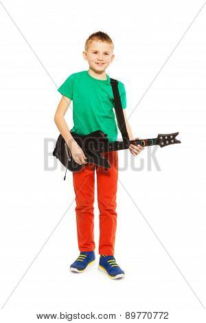 View of boy playing on electro guitar standing