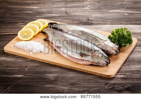 Fresh raw trouts on cutting board