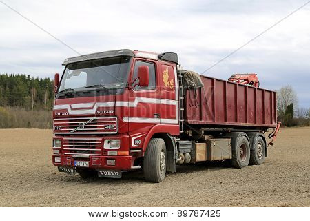 Early Red Volvo FH12 Truck Parked On A Field