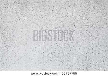 White Concrete Wall With Relief Plaster Pattern