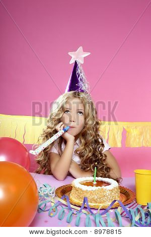 little blond girl in a birthday